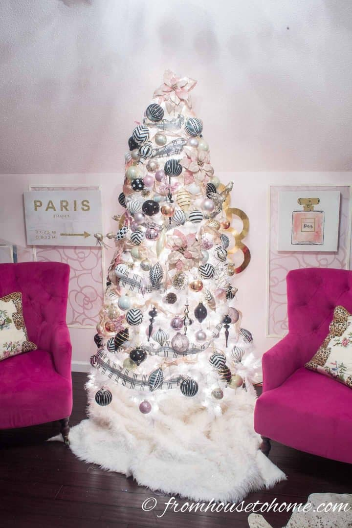 Pink, black and white Christmas tree in a pink room