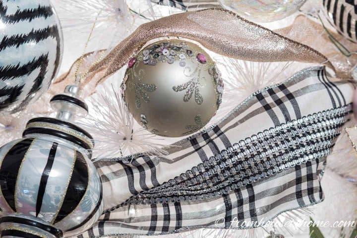 Black and white ribbon and blush pink ribbon on a white Christmas tree