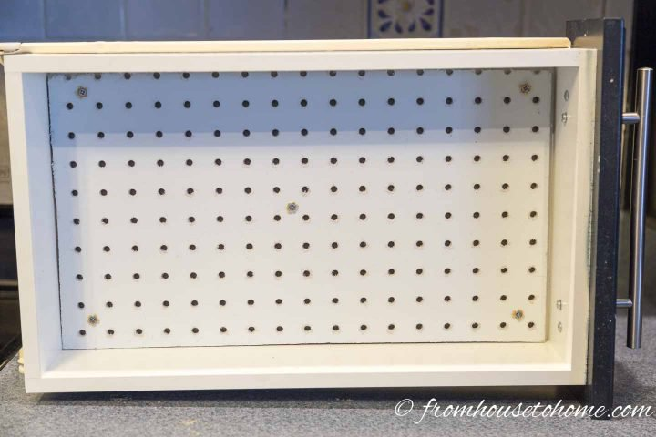 The pegboard installed on the bottom of the drawer