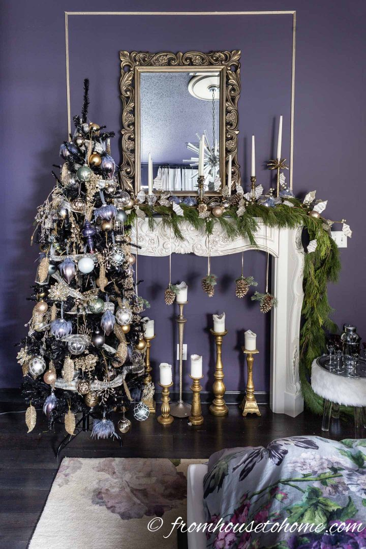 Purple and gold Christmas tree in front of a white fireplace mantel