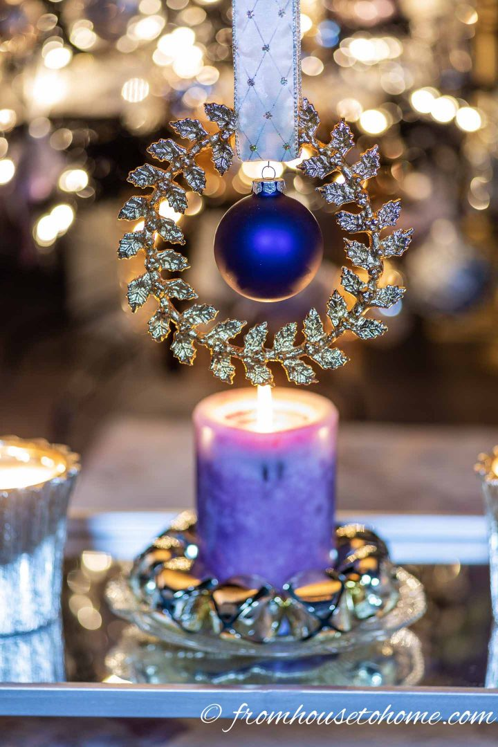 Purple and gold Christmas decorations on a bar cart
