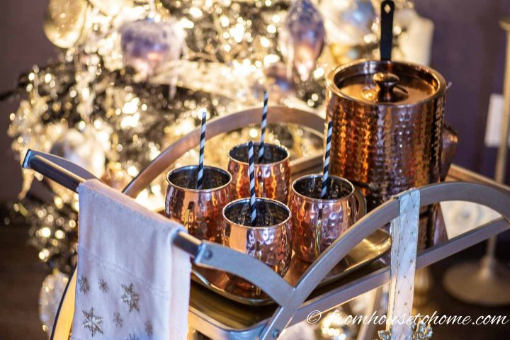 Hot cider in copper cups served on a bar cart