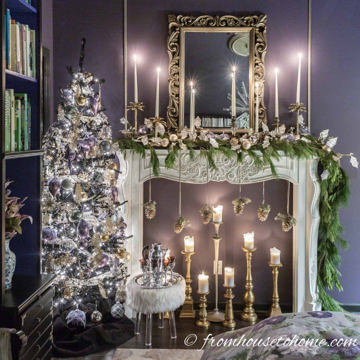 Purple and gold Christmas decorations on a Christmas tree and fireplace mantel