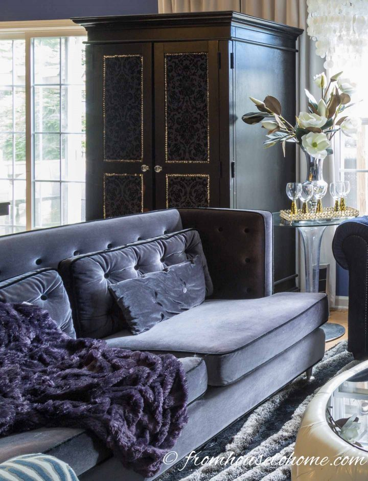 Grey velvet sofa in a contemporary glam living room