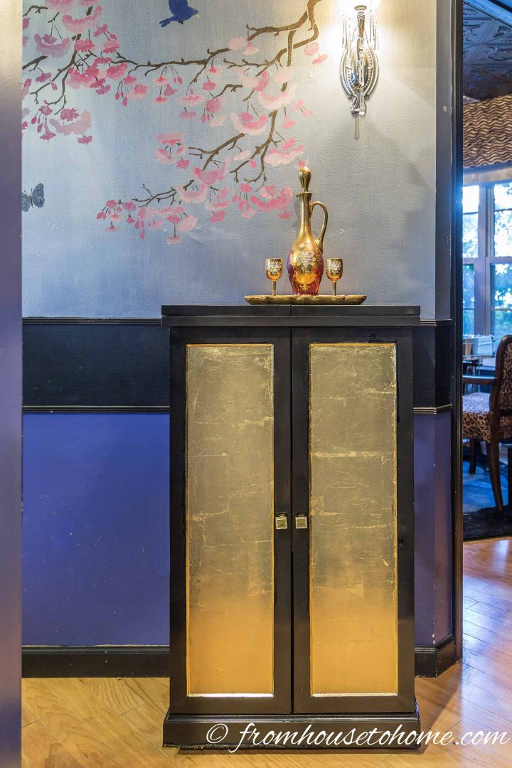 Black lacquer bar with gold leaf front in a Hollywood glam interior design