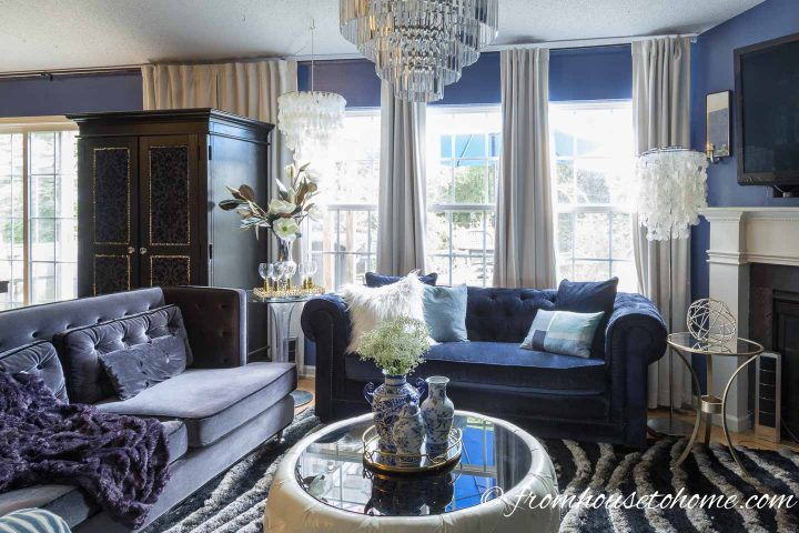 White velvet curtains in a blue contemporary glam living room