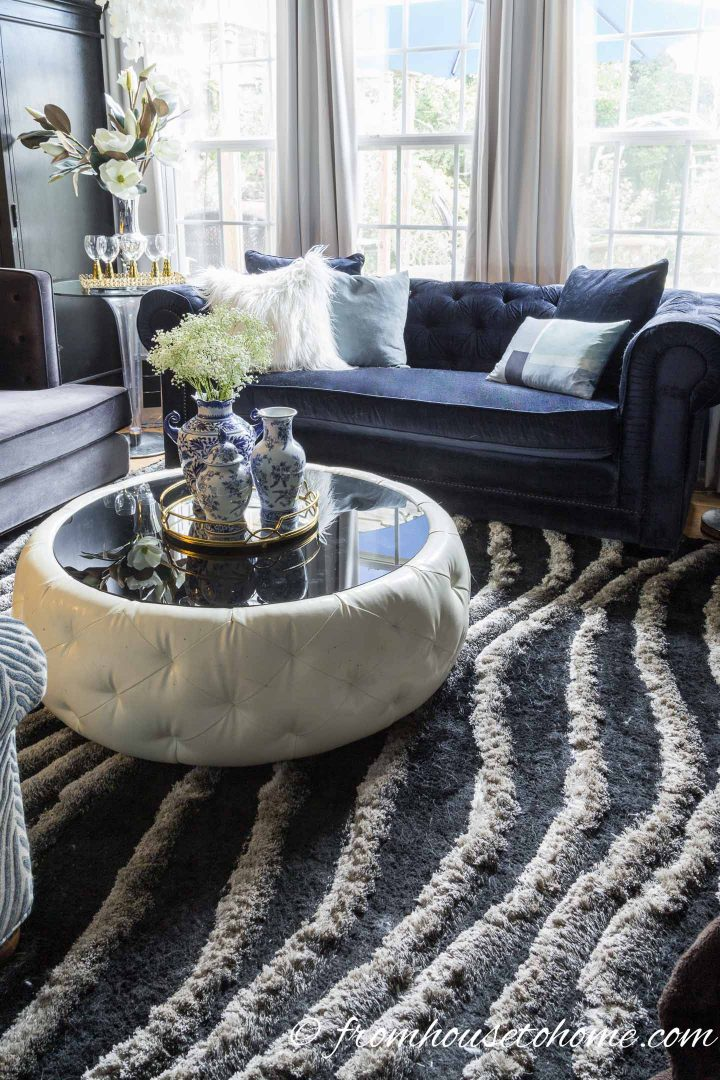 Contemporary glam living room with a plush black and grey area rug