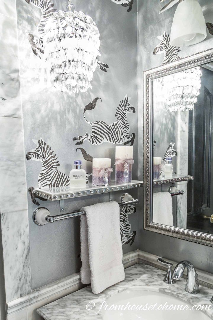 Silver shelf with crystal nail head trim in a Hollywood glam bathroom