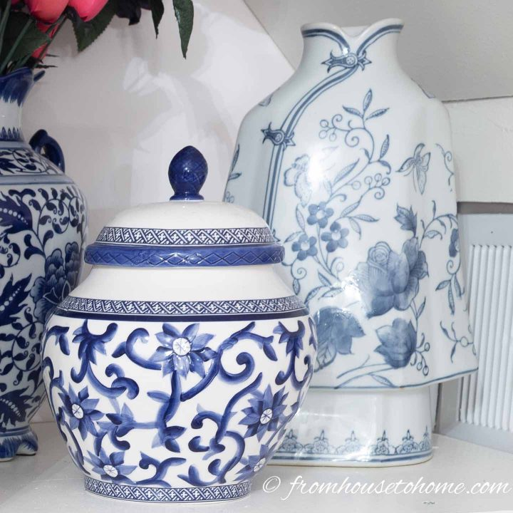 Blue and white ginger jars used for storing buttons on a sewing room shelf