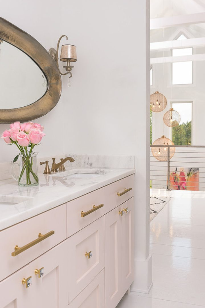 Marble countertop in a blush pink and gold modern glam bathroom