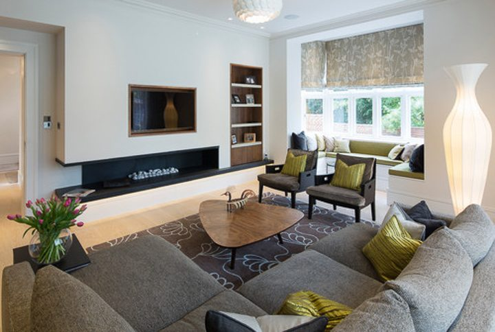 Contemporary living room furniture arrangement with sectional facing fireplace