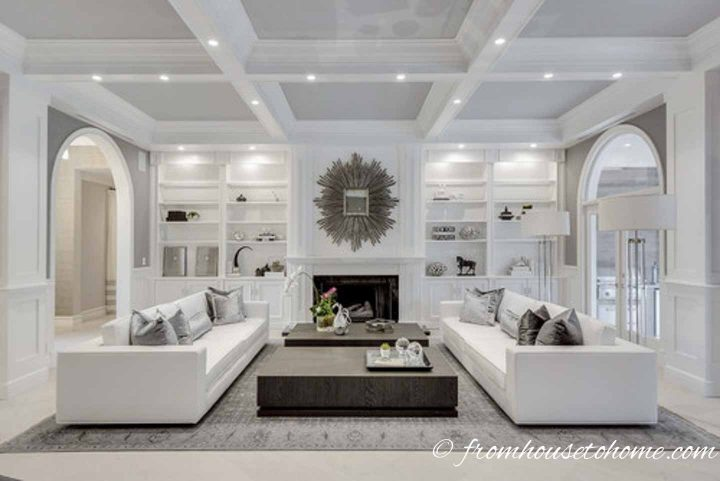 Living room layout with sofas perpendicular to the fireplace
