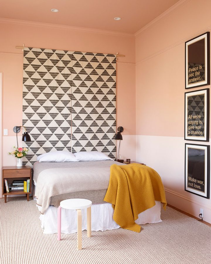 Bedroom with bottom third of wall painted a different color to look like wainscoting