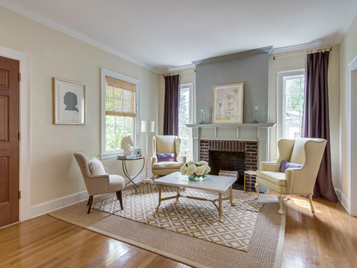 Living room with small rug on top of larger rug