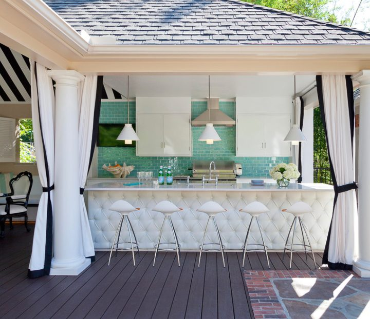 White upholstered outdoor bar with turquoise backsplash via traditionalhome.com