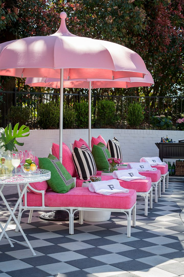 Pink, black and white Palm Beach chic outdoor decor on a black and white patio via traditionalhome.com