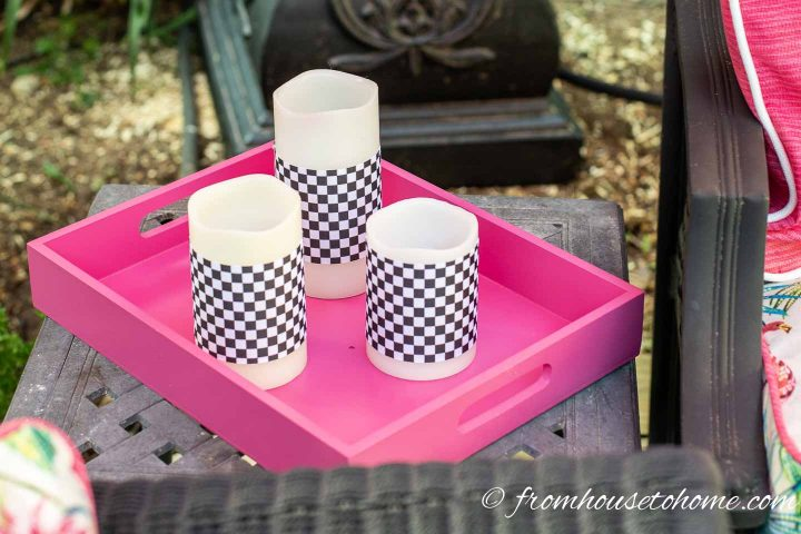 White and black flame-less candles on a pink tray