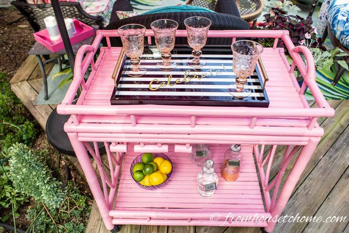 Black and white tray on a pink bamboo outdoor bar cart