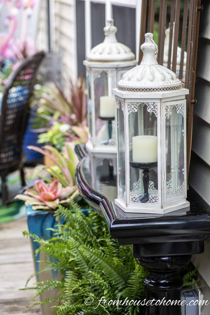 White lanterns on a black outdoor console table