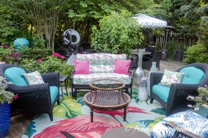 Colorful cushions on outdoor wicker furniture