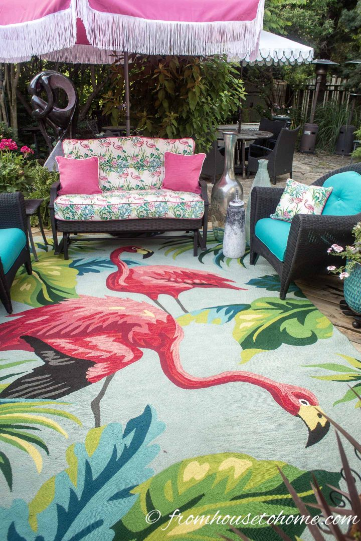 Outdoor rug with a flamingo pattern on a turquoise background
