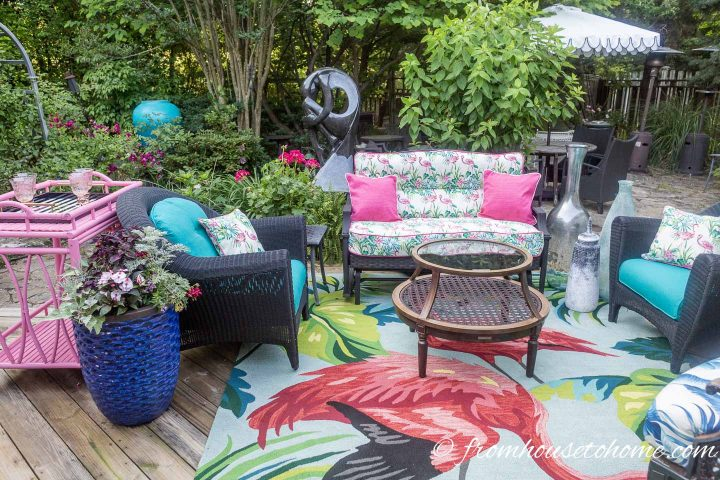Deck makeover with tall glass jars in a conversation area of outdoor furniture