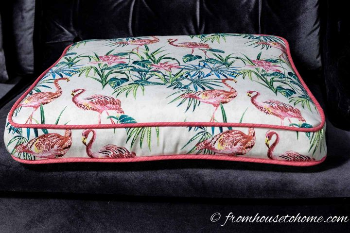 The finished box cushion with piping and a zipper