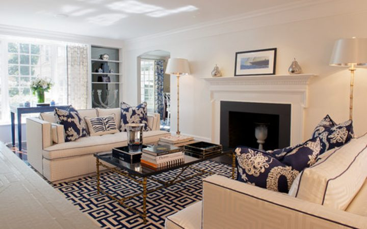 Blue and white living room with patterned rug and cushions