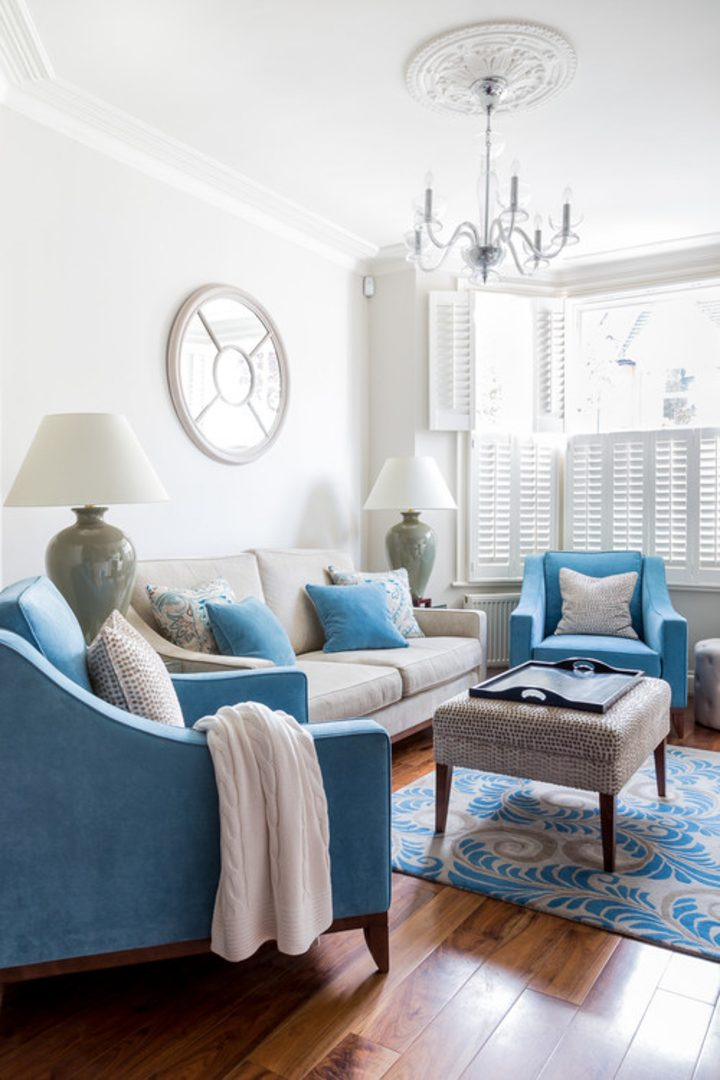 Living room with white walls and blue chairs