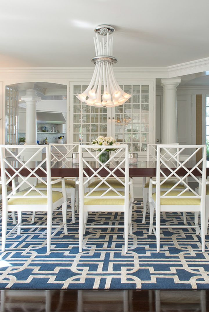 Blue and white dining room with yellow chairs