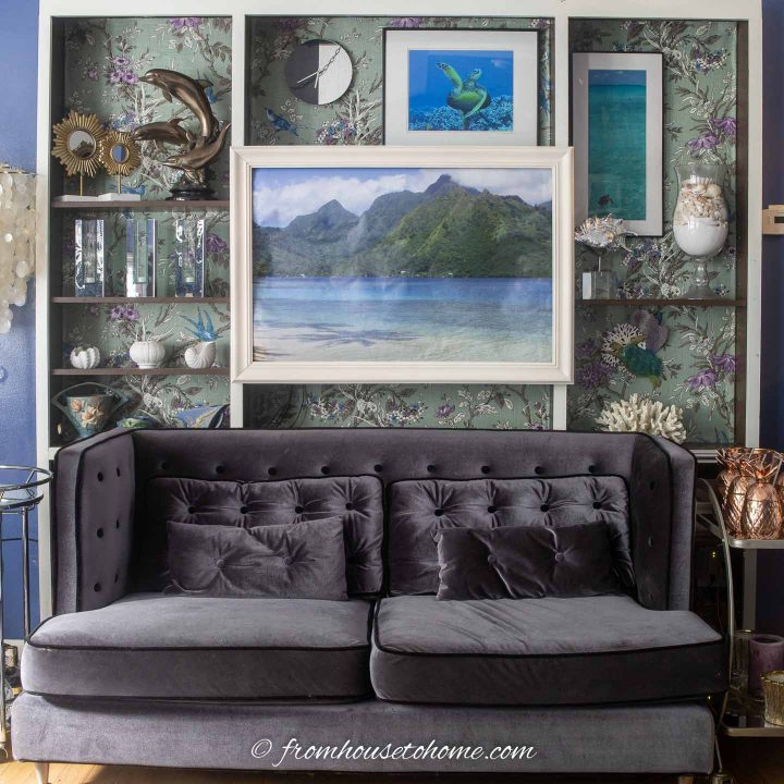 Blue and white living room with ocean scene picture
