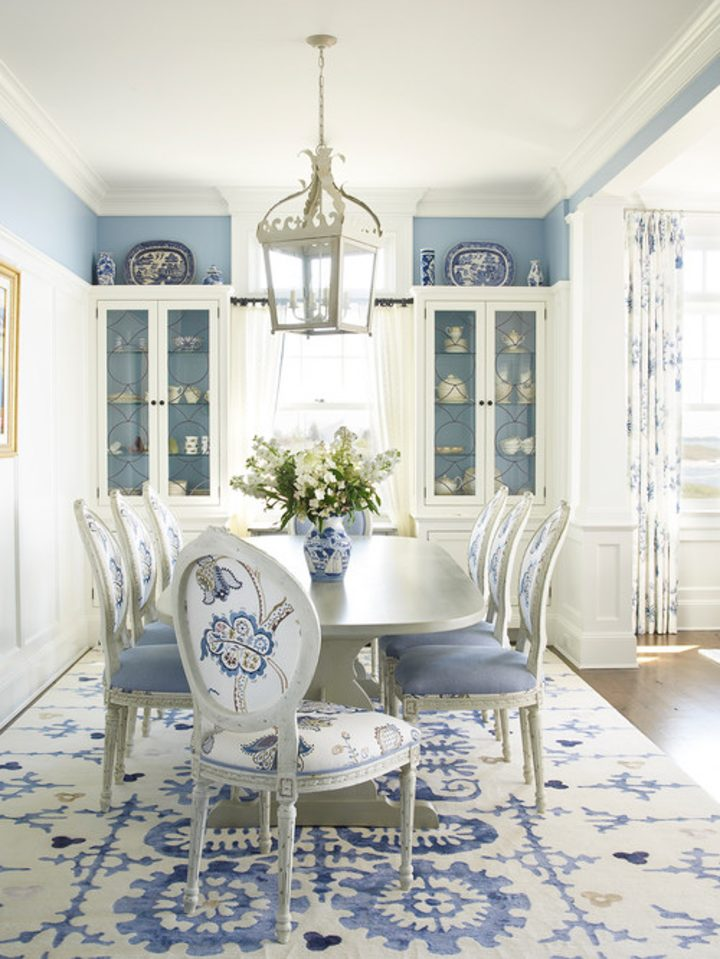 Blue and white dining room with blue walls