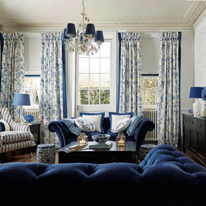 Blue and white living room with patterned curtains