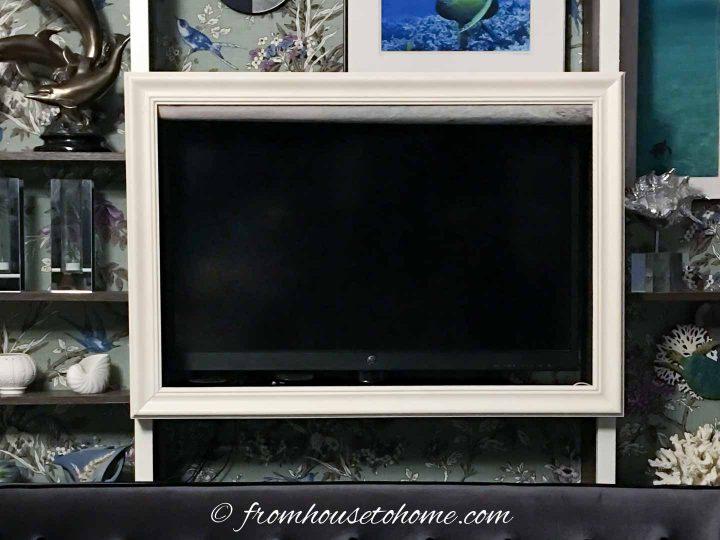 DIY TV frame around a TV on a shelf