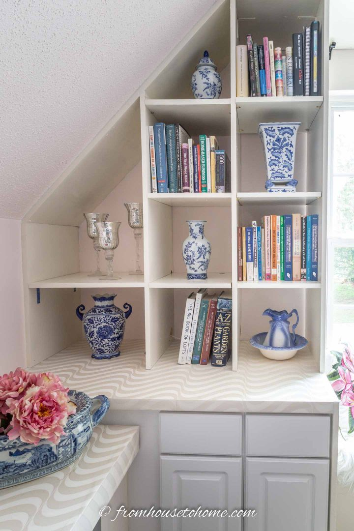 Blue and white ginger jars on a shelf