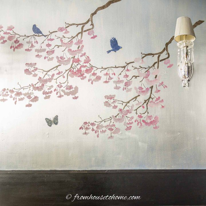 Wall stenciled with cherry trees to look like Chinoiserie wallpaper