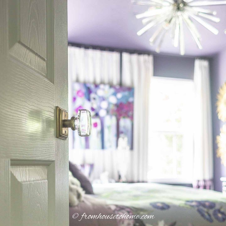 Door with upgraded handle looking into bedroom