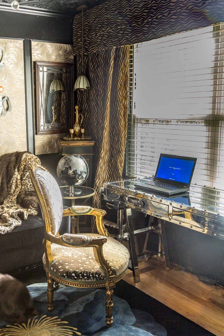 Home office with velvet drapes and a metal desk