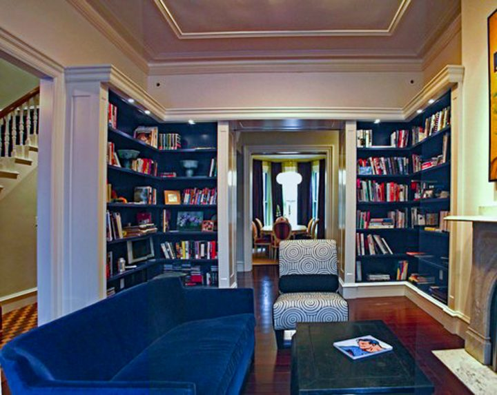 Home library at one end of a small living room