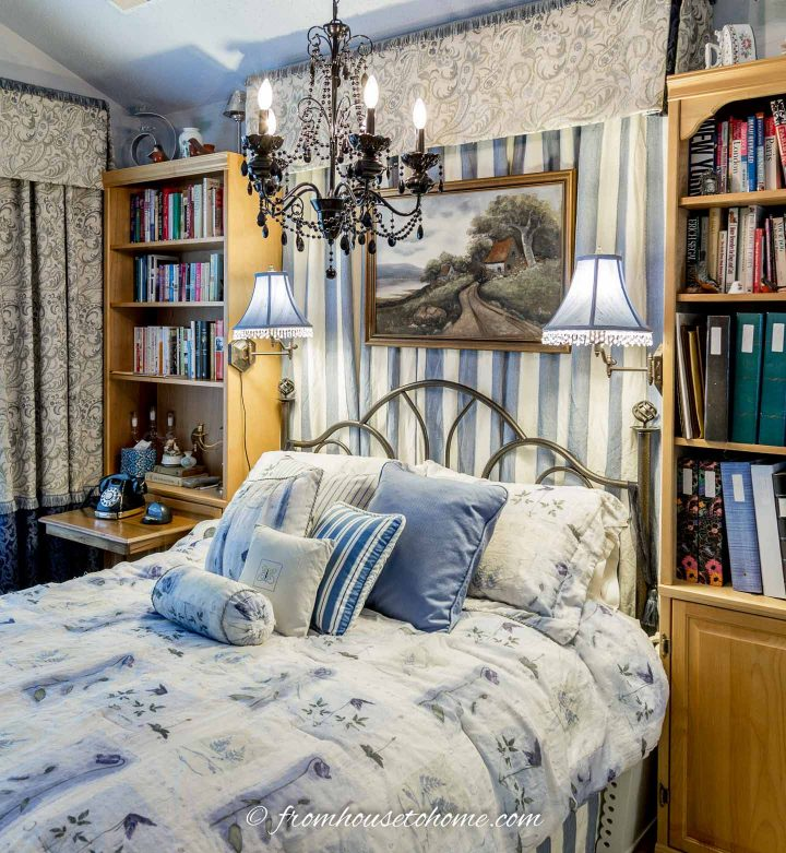 Small bedroom library with bookcases on either side of the bed