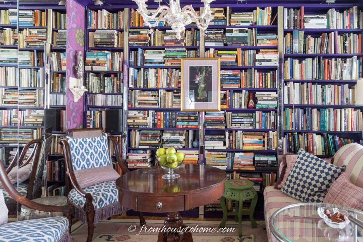 Living room home library with a wall of books