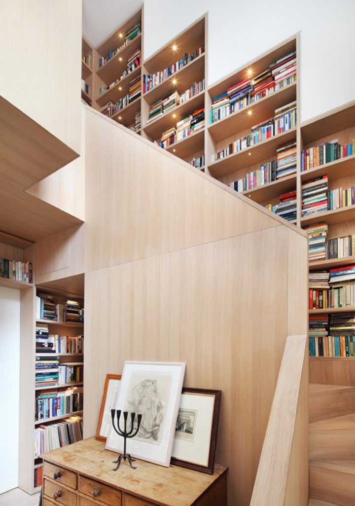 Home library built into a stairway