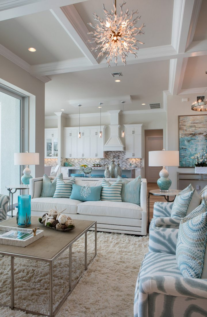 Coastal themed living room with two sofas around a square coffee table