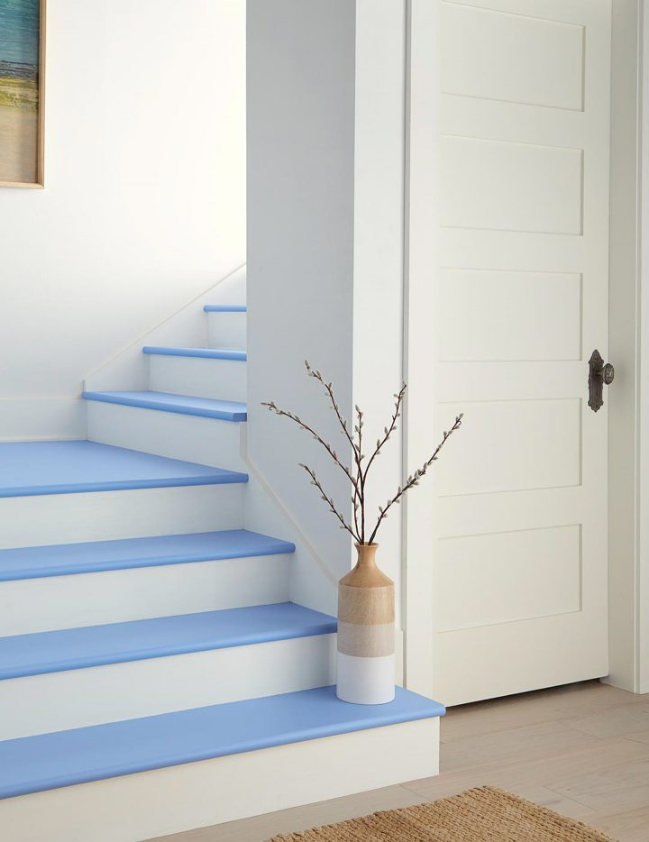 Stair treads painted with Behr's 'Bluebird', one of their 2020 color trends selections