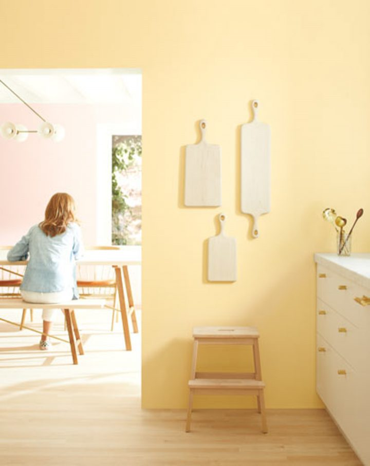 Kitchen wall painted in Benjamin Moore's 'Golden Straw', one of the 2020 paint color trends