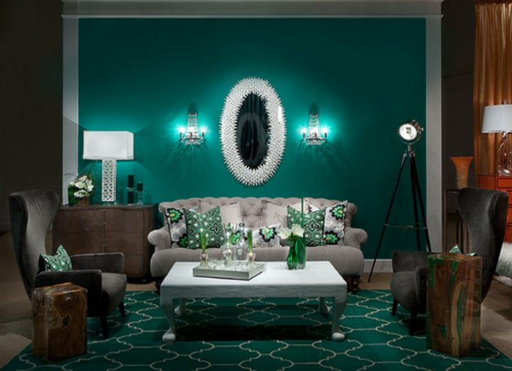 Emerald green living room with a white sofa and table lamps