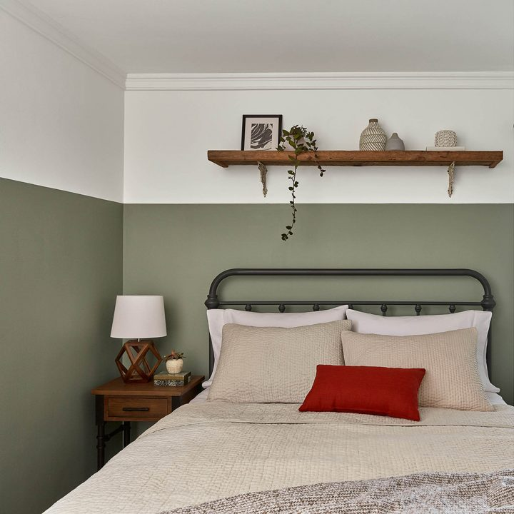 Bedroom wall painted with Valspar's 'Secret Moss', one of the 2020 paint color trends