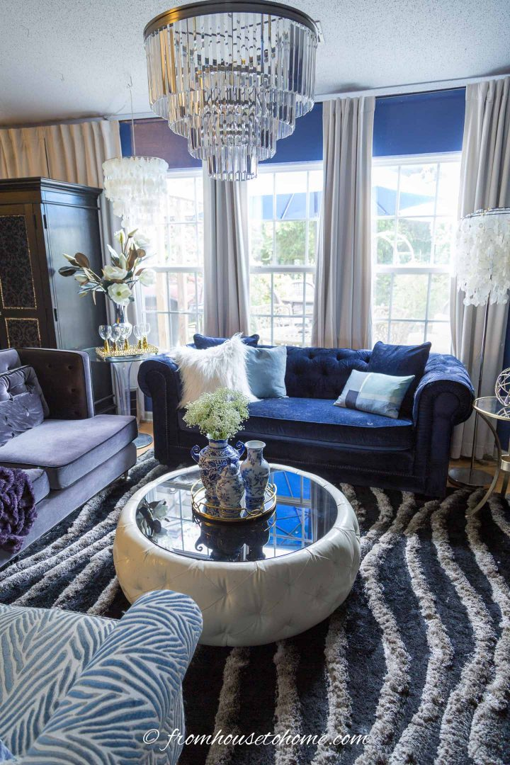 Living room layout with a large black and gray area rug and sofas