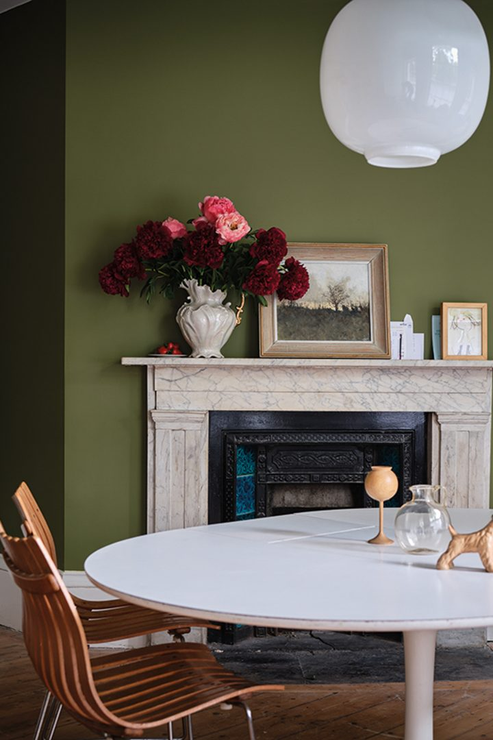 Living room wall painted with Farrow and Ball's 'Sap Green'