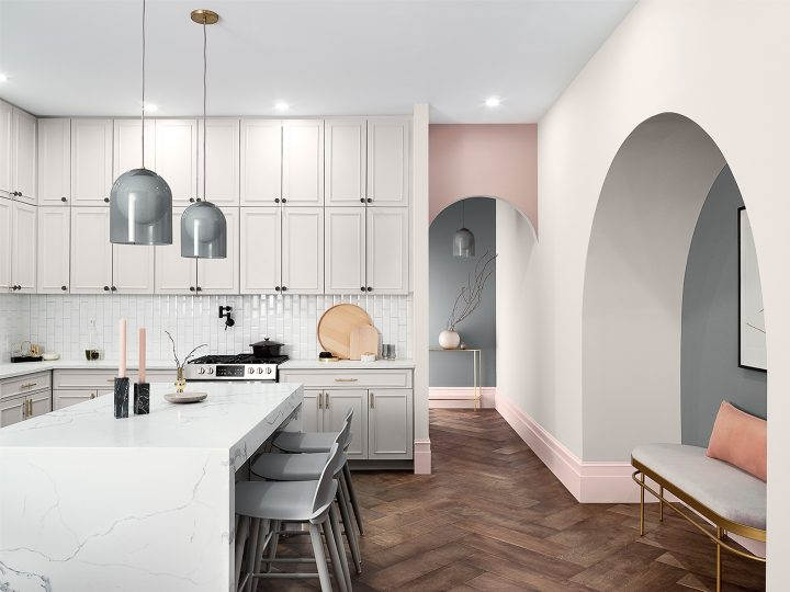 Kitchen painted in greige paint colors with blush pink accents from Sherwin William's Mantra 2020 paint color collection